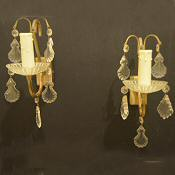 Circa 1960 pretty pair of brass and crystal wall lights