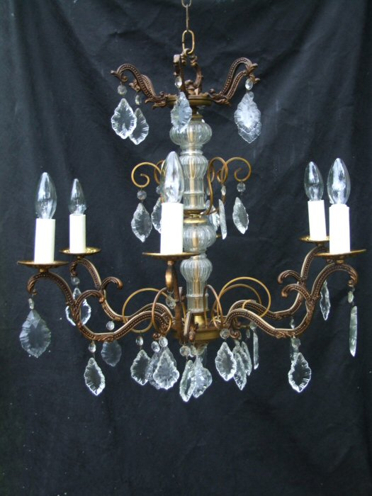 Circa 1900 A 6 arm patinated Brass and Crystal Chandelier