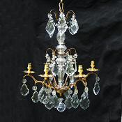 Circa 1900 A 6 arm Brass and Crystal Chandelier